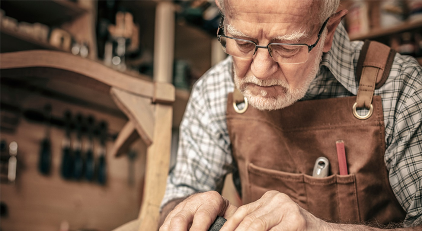 Craftsman working on a chair.