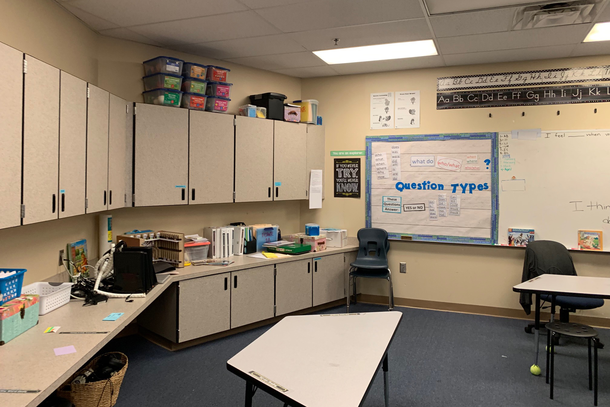 Wall of cabinets and white board in the winning classroom of Altamonte Elementary before renovation.